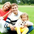 Outdoor happy caucasian family relaxing — Stock Photo