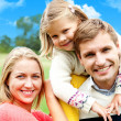 Beautiful happy caucasian family of three — Stock Photo