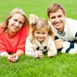 Portrait of a happy family of three — Stock Photo