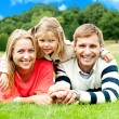 Happy young family with daughter outdoors — Stock Photo