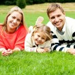 Young family of three spending a happy day outdoors — Stock Photo #13735901