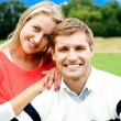 Happy young couple outdoor in spring — Stock Photo