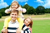 Happy smiling family outdoors — Stock Photo