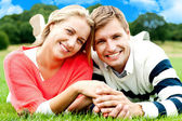Young beautiful couple loving each other in nature — Stock Photo