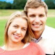 Profile shot of handsome loving couple — Stock Photo