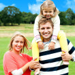 Fun loving family enjoying spring day outdoors - Stock Photo
