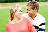 Couple admiring each other and smiling heartily — Stock Photo