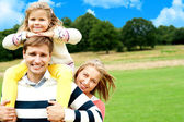 Family's day out in the park. Everyone enjoying — Stock Photo