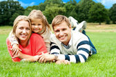 Joyous family in a park enjoying day out — Stock Photo