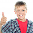 Boy in trendy clothes showing thumbs up sign — Stock Photo #13874921