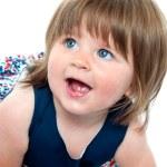Closeup shot of blonde cute baby girl crawling — Stock Photo