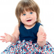 Stock Photo: Chubby little toddler wearing dotted blue frock