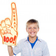Boy with a hurray boo foam hand. Young fan — Stock Photo #13874829