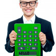 School boy holding calculator upside down — Stock Photo