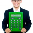 Bright young kid holding large green calculator — Stock Photo