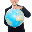 Cheerful boy in suit holding globe with both hands — Stock Photo