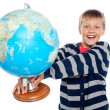 Excited school boy holding globe — Stock Photo