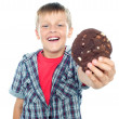 Cheerful boy offering you a chocolate cookie - Stockfoto