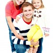 Portrait of happy parents with their daughter — Stock Photo #14150773