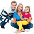 Portrait of happy couple smiling with cute daughter — Stock Photo