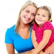 Adorable mom and daughter posing together — Stock Photo