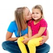 Beautiful mom kissing her pretty daughter — Stock Photo