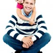 Daughter holding her father from behind — Stock Photo