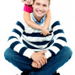 Daughter holding her father from behind — Stock Photo #14150864