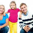 Gorgeous couple posing with beautiful girl child — Stock Photo #14150880