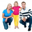 Studio portrait of charming young family — Stock Photo