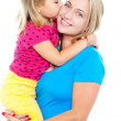 Fashionable young kid kissing her mother — Stock Photo #14150948