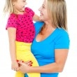 Gorgeous mother holding her beautiful daughter in arms — Stock Photo #14150979