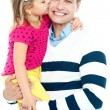 Sweet daughter kissing her smiling father — Stock Photo