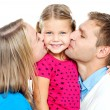 Mom and dad kissing their beautiful kid — Stock Photo