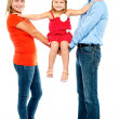 Stock Photo: Baby girl sitting on outstretched arms of her parents
