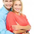 Happy man embracing his wife from behind — Stock Photo