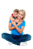 Cute daughter hugging her mother from behind — Stock Photo