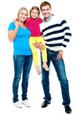 Full length portrait of a cheerful family of three — Stock Photo