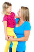 Gorgeous mother holding her beautiful daughter in arms — Stock Photo