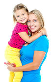 Cute daughter hugging her mom. Casual shot — Stock Photo