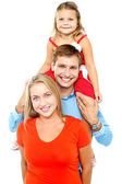 Portrait of cheerful family of three having fun — Stock Photo