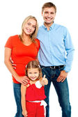 Smiling family on a white background — Stockfoto