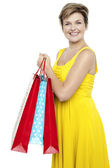 Pretty woman holding colorful shopping bags — Stock Photo