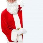 Aged Santa holding blank white banner ad board — Stock Photo #15658233