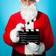 Royalty-Free Stock Photo: Bespectacled Santa holding a clapperboard