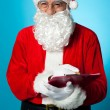 Santa Claus making his list of the good children — Stock Photo #15657629