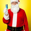 Stock Photo: Male in Santa costume posing with his cash card