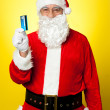 Male in Santa costume posing with his cash card — Stock Photo