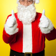 Cheerful male in Santa costume showing double thumbs up — Stock Photo