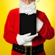 Kris Kringle presenting new updated tablet pc — Stock Photo